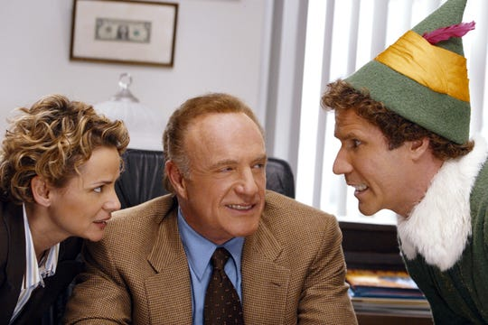 Amy Sedaris, James Caan and Will Ferrell in the movie Elf.