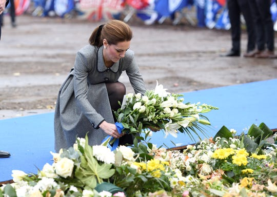 Duchess Kate of Cambridge lays flowers at the memorial at Leicester City Football Club for victims of an October helicopter crash at the club stadium that killed five people, including the club owner, in Leicester, central England on Nov. 28, 2018.