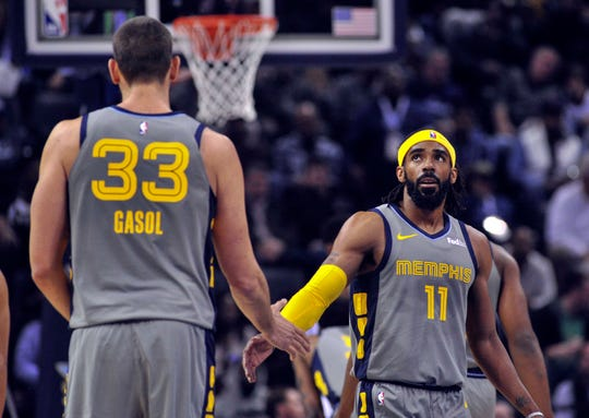 Marc Gasol and Mike Conley during the first half of a game against the 76ers.