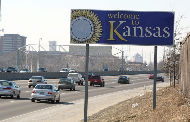 A Welcome to Kansas sign in Johnson County, KS.