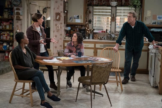 As Jackie (Laurie Metcalf), second from left, explains her plan to build a chicken coop, Dan (John Goodman) digs in to oppose. Geena, seated left, and Darlene (Sara Gilbert), take in the battle.