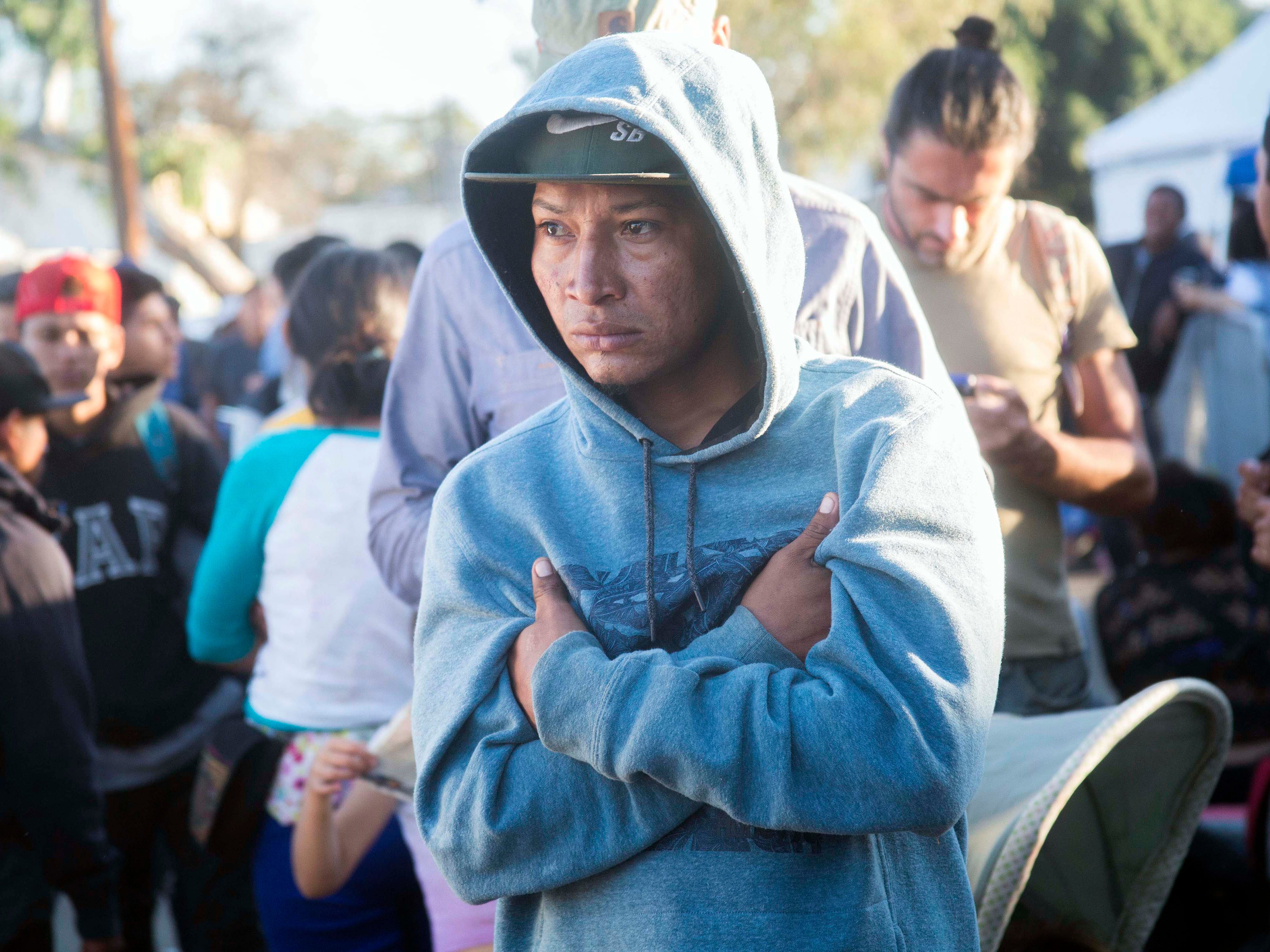 A migrant man listens to his peers on Nov 26, 2018, as they discuss the possibility of returning back to Honduras outside the Benito Juarez shelter, which  houses more than 5000 migrants in Tijuana, Mexico.