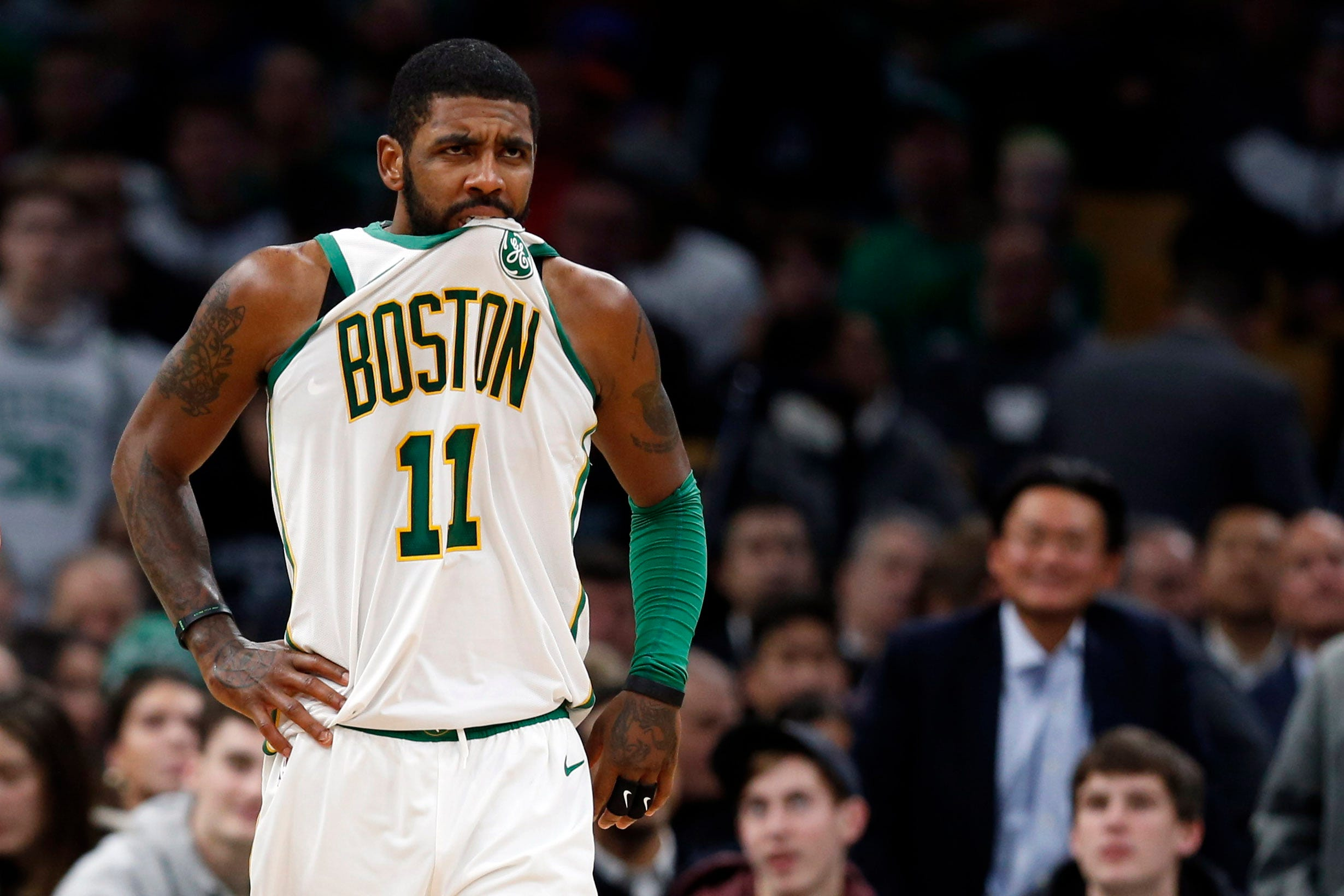 Boston Celtics guard Kyrie Irving reacts during the second half of a game against the New York Knicks at TD Garden.