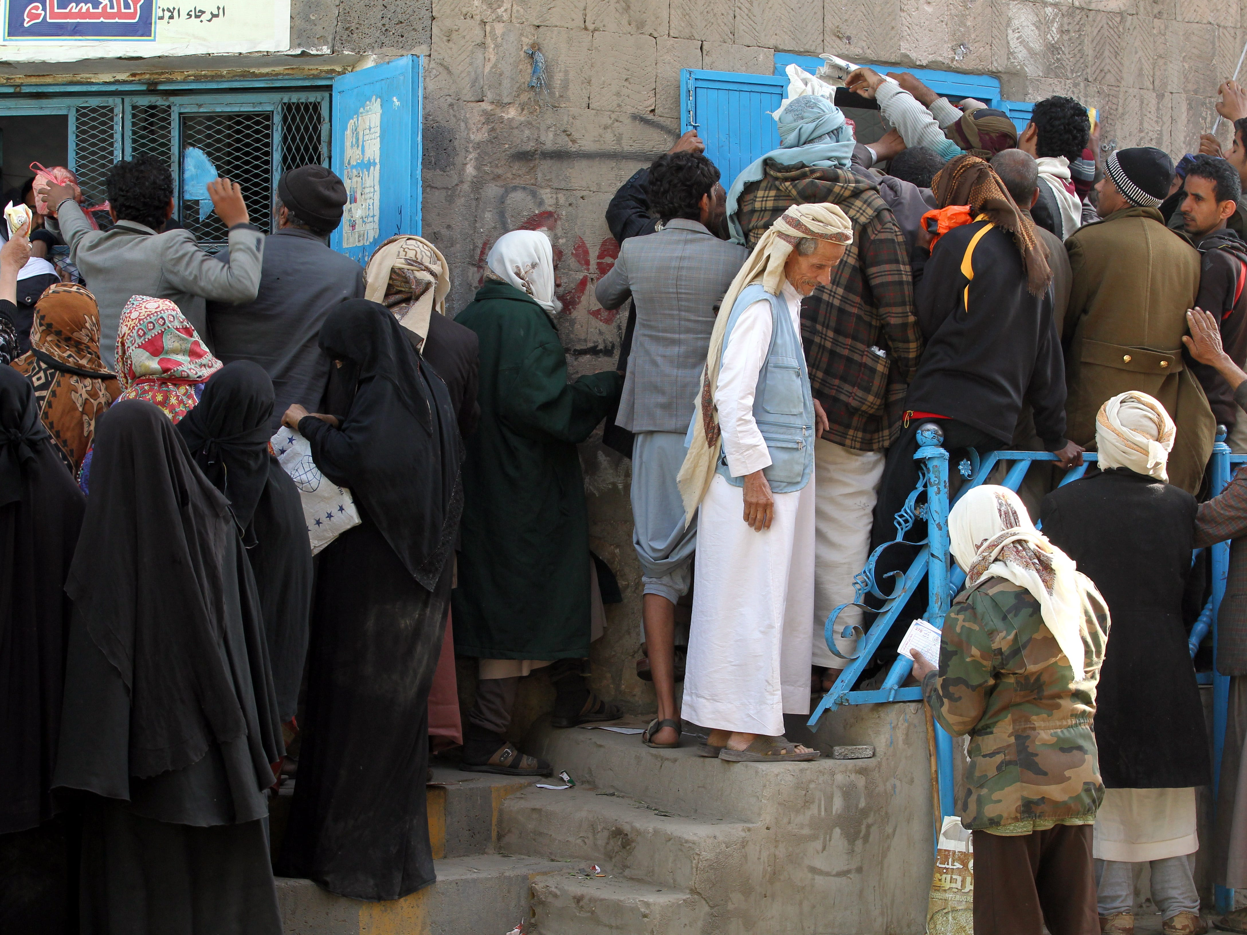 Yemenis gather to receive free bread by a local charity bakery amid a severe shortage of food in Sana'a, Yemen, Nov. 28, 2018.
