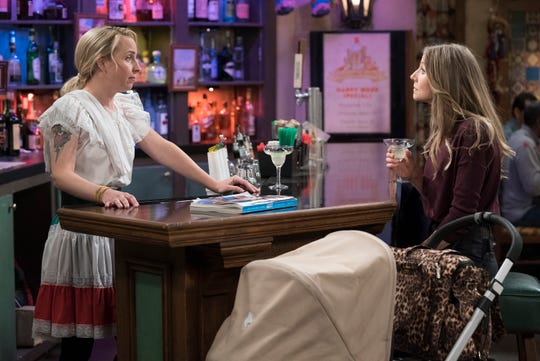 Becky (Lecy Goranson), left, talks to new mom Andrea (Sarah Chalke, who succeeded Goranson as Becky in the original 'Roseanne') on Tuesday's episode of ABC's 'The Conners.'