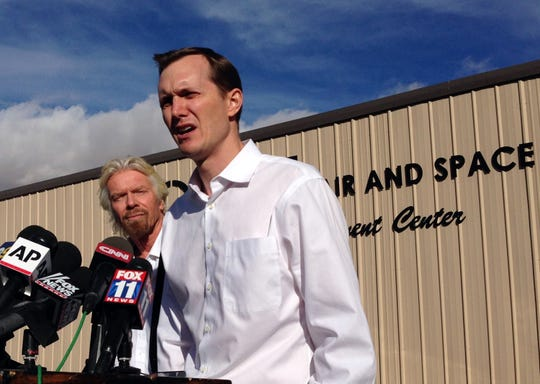 Shown here at a news conference following the 2014 crash of their spaceship Virgin Galactic founder Richard Branson, left, and CEO George Whitesides address reporters. The NTSB investigation found that poor design led to the pilot-error that caused the crash. Virgin then formed its own company, The Spaceship Company, to build its own redesigned craft in the wake of the incident.