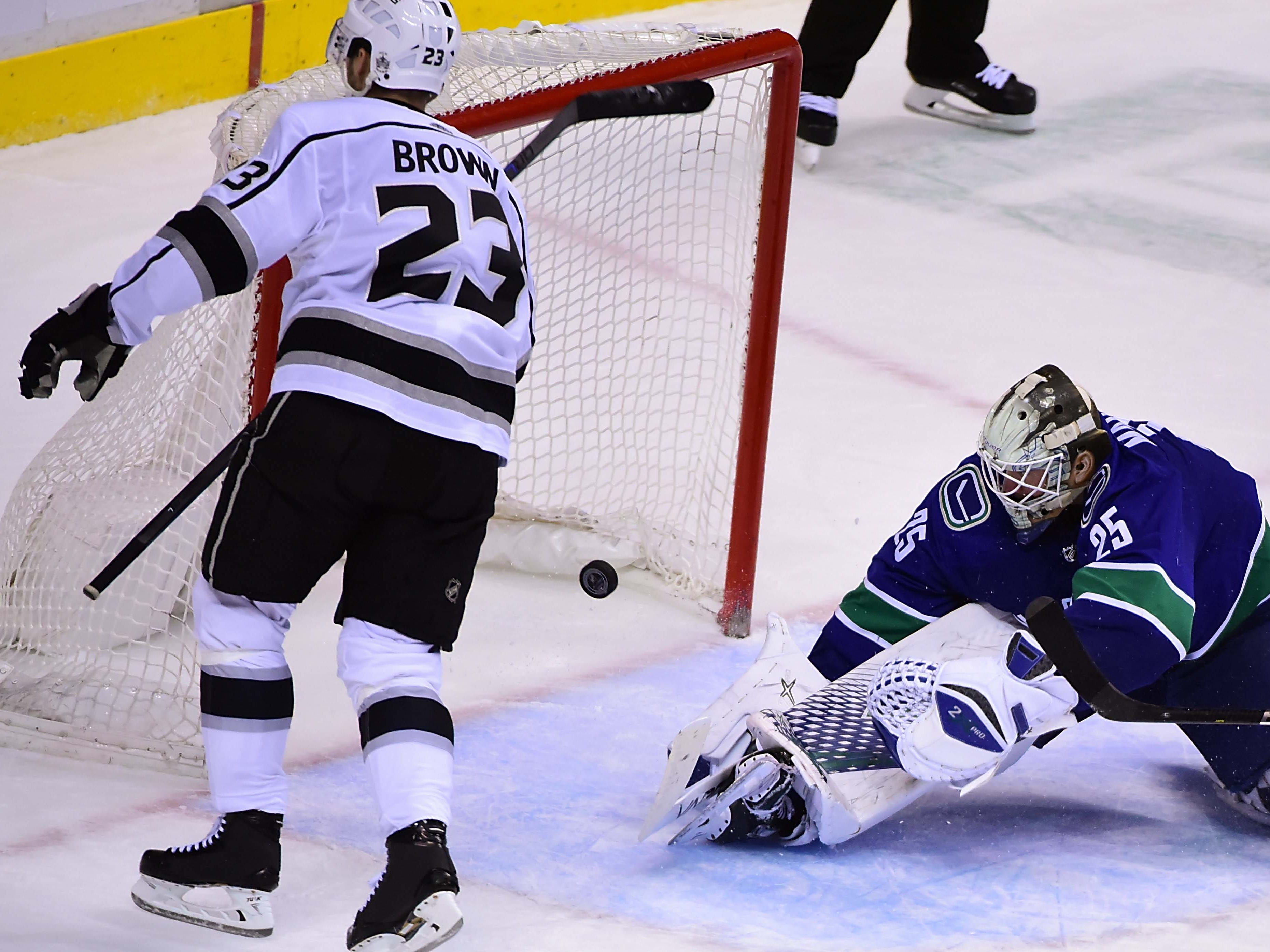 Los Angeles Kings forward Dustin Brown scored in overtime against the Vancouver Canucks to stay hot. He had a hat trick in his previous game.