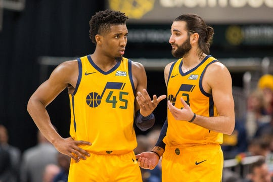 Donovan Mitchell and Ricky Rubio talk during a free throw during a game against the Pacers.