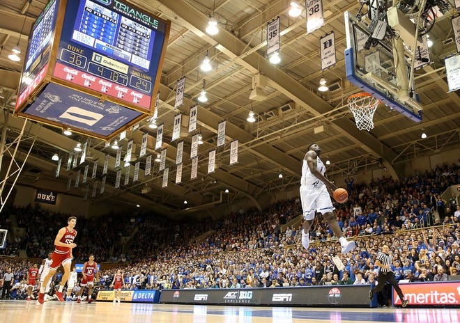 Zion Williamson dunks the ball against the Indiana at Cameron Indoor Stadium.