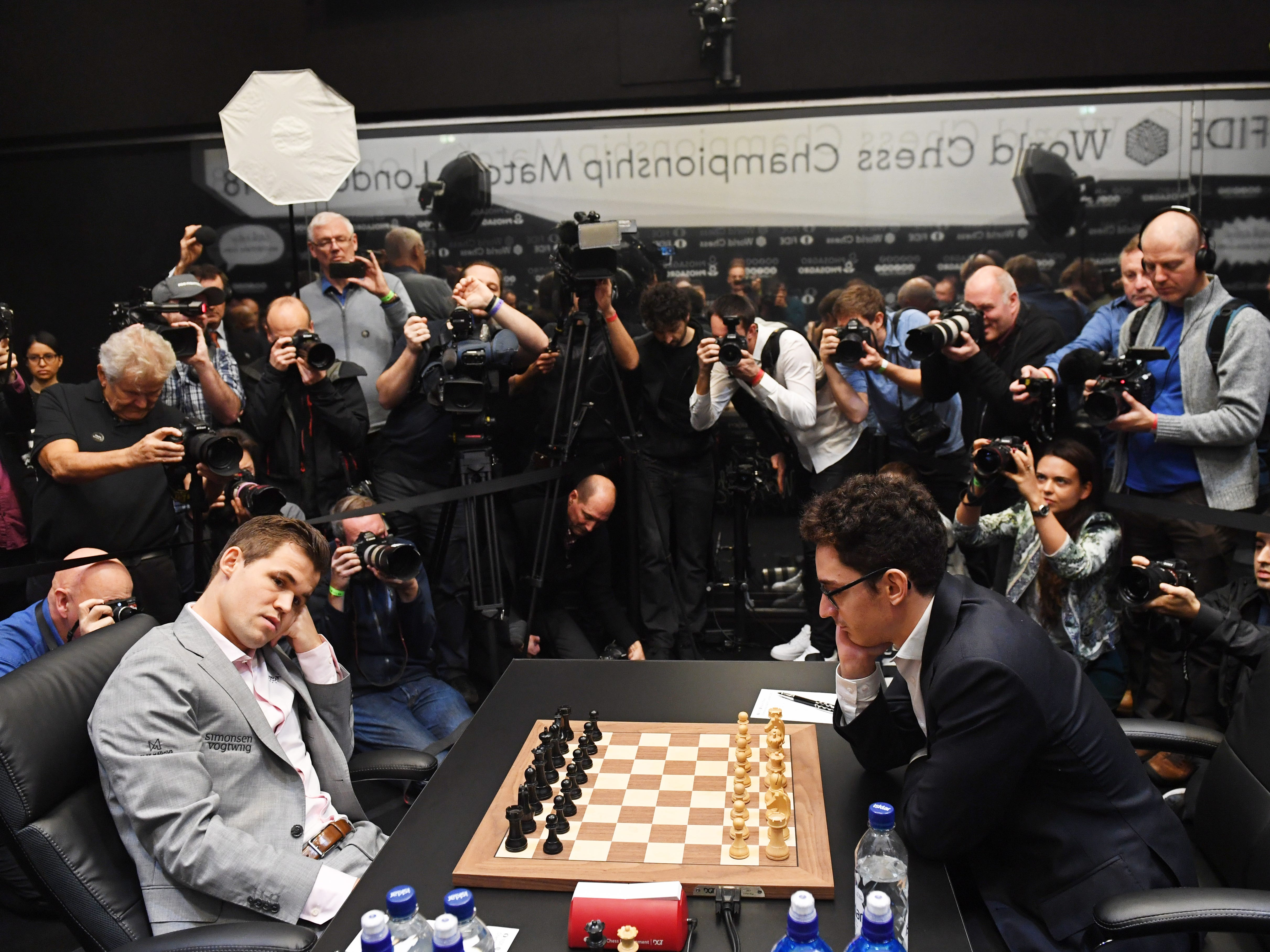 Reigning chess world champion Magnus Carlsen, left, plays against American challenger Fabiano Caruana at the round twelve game during the World Chess Championship, Nov. 26, 2018, in London.
