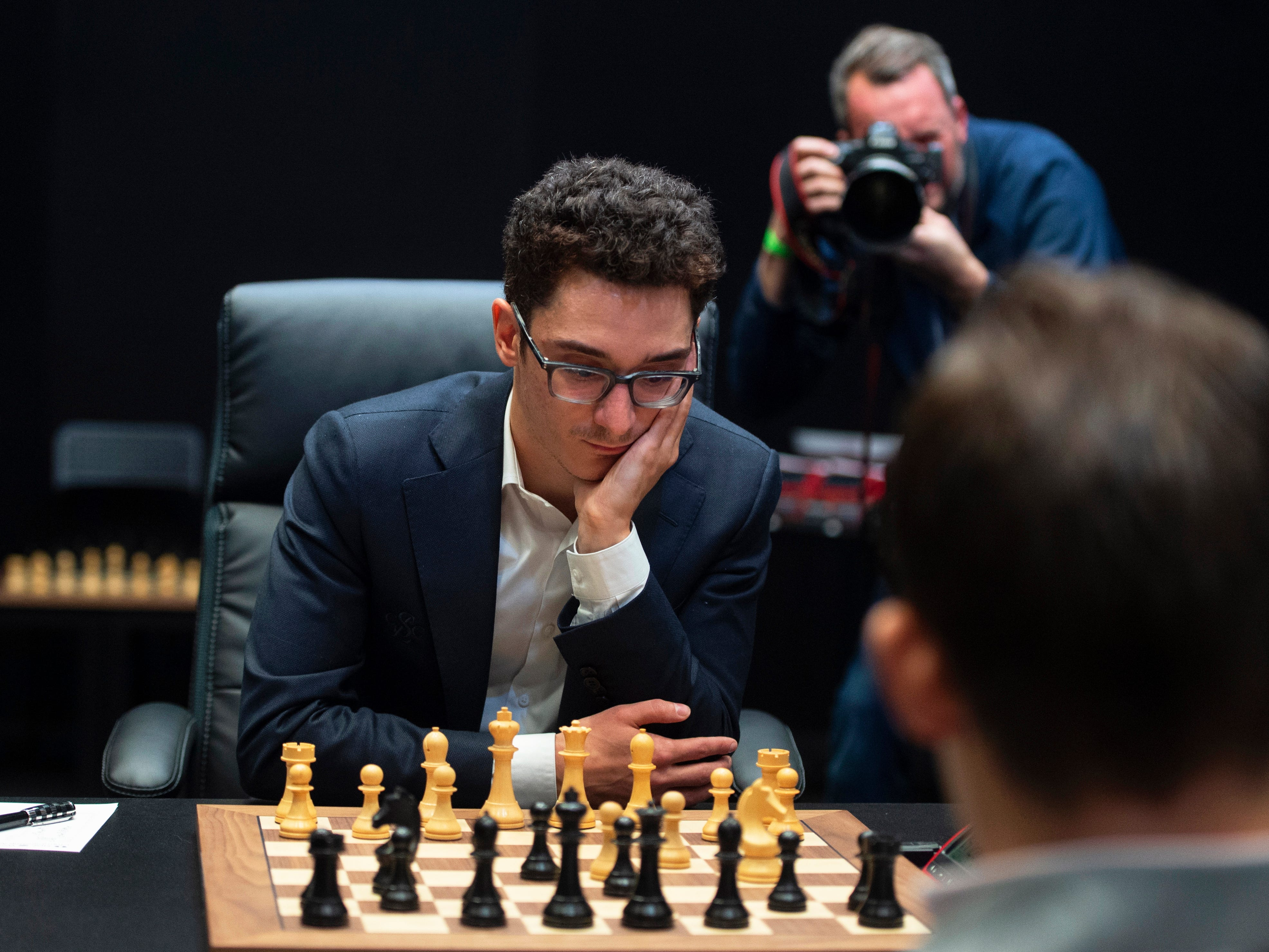 American challenger Fabiano Caruana, left, plays against reigning chess world champion Magnus Carlsen at the round 12 game during the World Chess Championship, Nov. 26, 2018, in London.