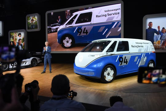 Scott Keogh president and CEO of Volkswagen Group, shows off the company's concept cargo van during press preview day at Los Angeles Auto Show.