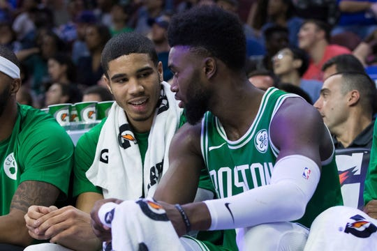 Jayson Tatum talks with Jaylen Brown.