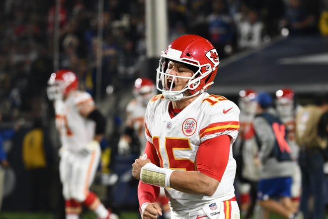 Kansas City Chiefs quarterback Patrick Mahomes (15) celebrates after a touchdown pass to Kansas City Chiefs running back Kareem Hunt (not pictured) in the second quarter against the Los Angeles Rams at the Los Angeles Memorial Coliseum.