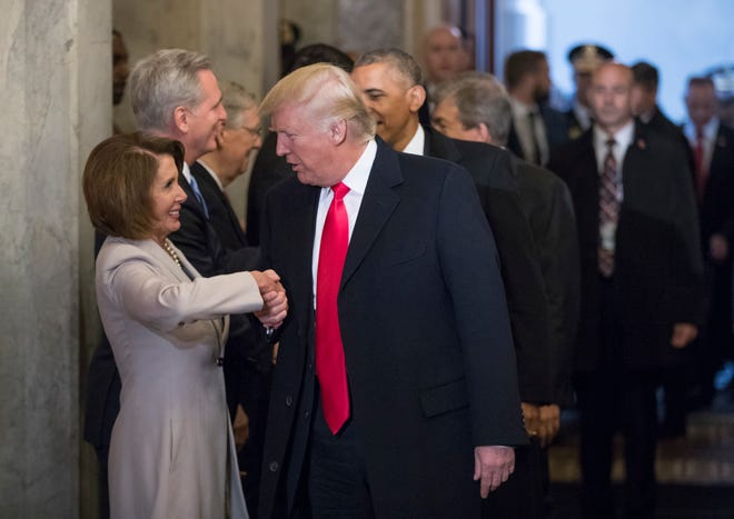 In this file photo from Friday, Jan. 20, 2017, then-President-elect Donald Trump greets House Minority Leader Nancy Pelosi of California.
