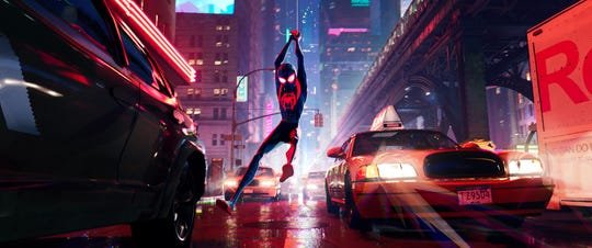 "Miles Morales (Shameik Moore) swings through New York in fresh threads in ""Spider-Man: Into the Spider-Verse."""