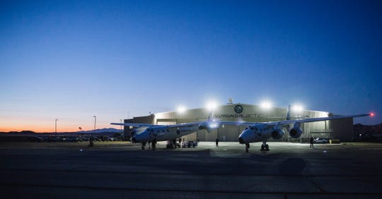 Virgin Galactic's WhiteKnightTwo, the mothership that cradles SpaceShipTwo under its wings, gets checked out before another dawn test flight. WK2 takes SS2 up to 50,000 feet, then drops it. The rocket fires on SS2, and carries the craft straight up for 60 seconds, eventually reaching space at 50 miles high.