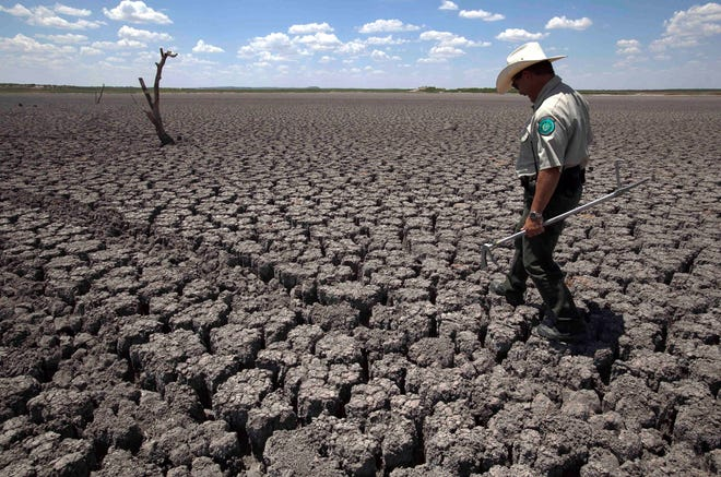 "A drought in 2011 parched O.C. Fisher Lake in San Angelo, Texas. Fueled in part by human-caused climate change, a ""megadrought"" appears to be emerging in the western U.S., a study published Thursday suggests."