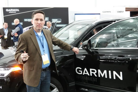A new infotainment system from Garmin will let you open the car with your smartwatch. Pictured: Garmin's Kip Dondlinger