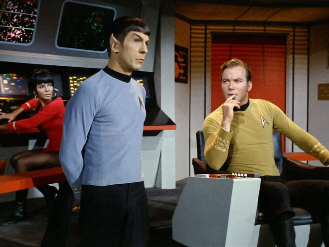 Nichelle Nichols as Lt. Uhura, Leonard Nimoy as Mr. Spock, center, and William Shatner as Captain James T. Kirk explore the universe from the bridge of the USS Enterprise.