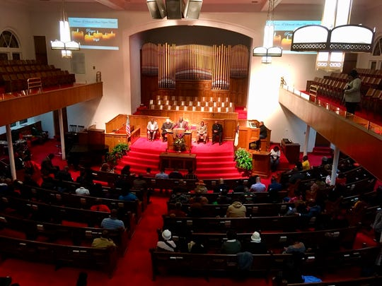 "A crowd gathers at 16th Street Baptist Church in Birmingham, Alabama, on Tuesday night for a community vigil following the shooting death of Emantic ""EJ"" Bradford Jr."