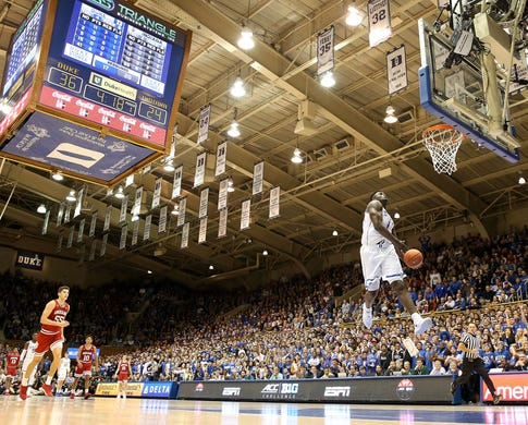 Zion Williamson does a windmill dunk against Indiana at Cameron Indoor Stadium.