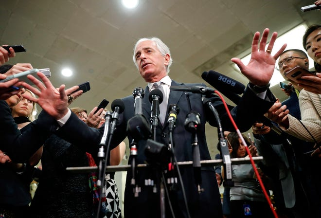 Sen. Bob Corker, R-Tenn., speaks to members of the media after leaving a closed door meeting about Saudi Arabia on Nov. 28 on Capitol Hill in Washington.