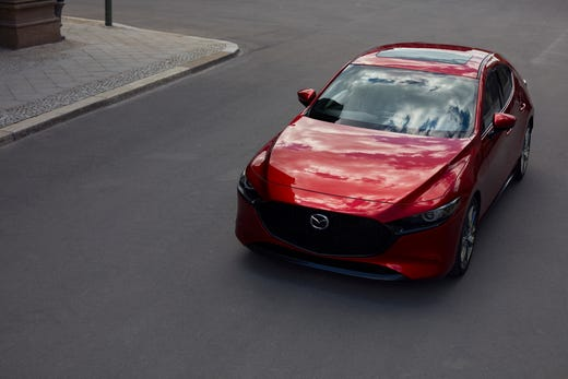 The Redesigned Mazda3 Seen Here In A Corporate Photo Shoot Debuted At An Event