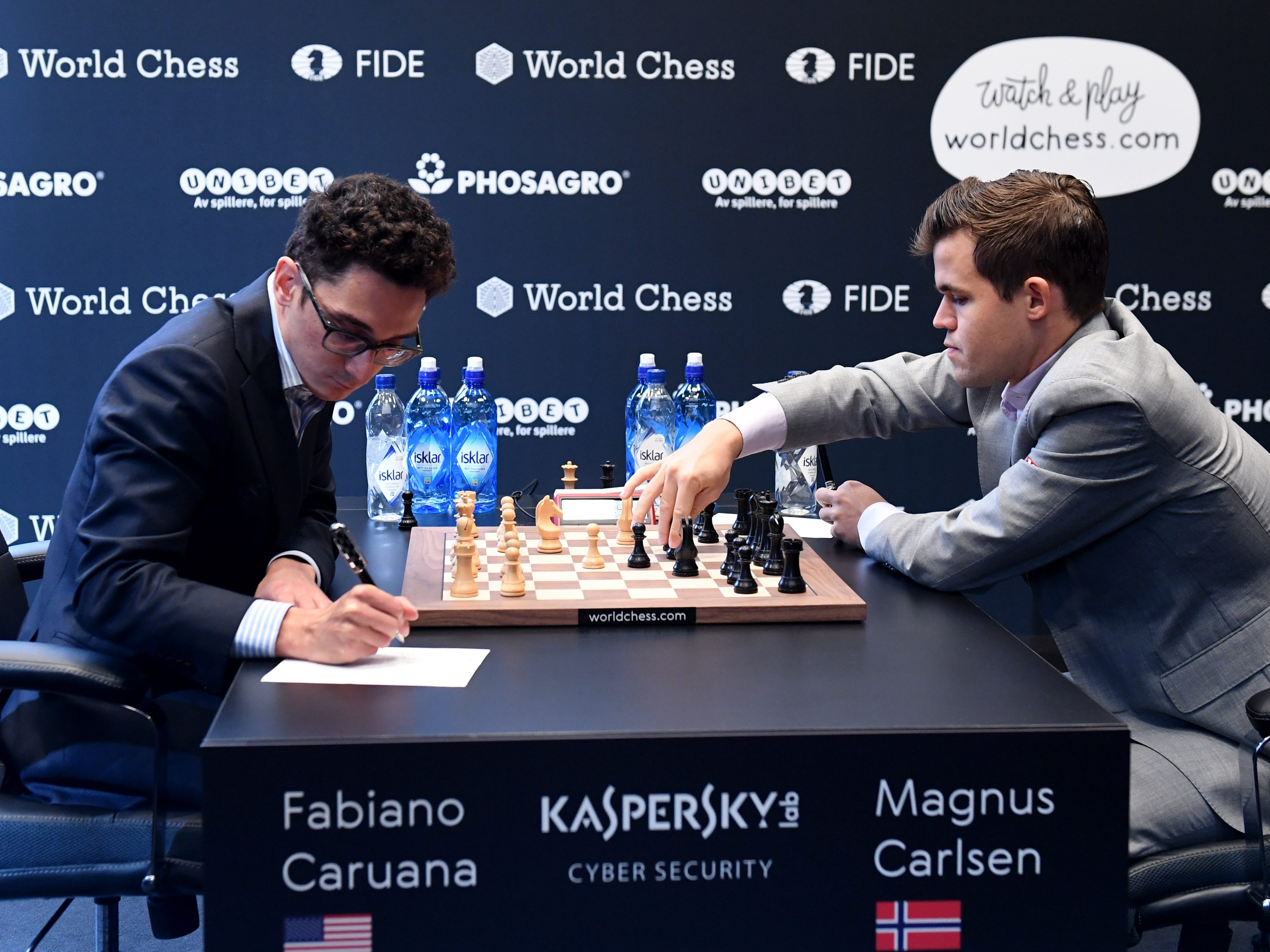 Reigning chess world champion Magnus Carlsen, right, plays against American challenger Fabiano Caruana during round 10 of the World Chess Championship, Nov. 22, 2018, in London.