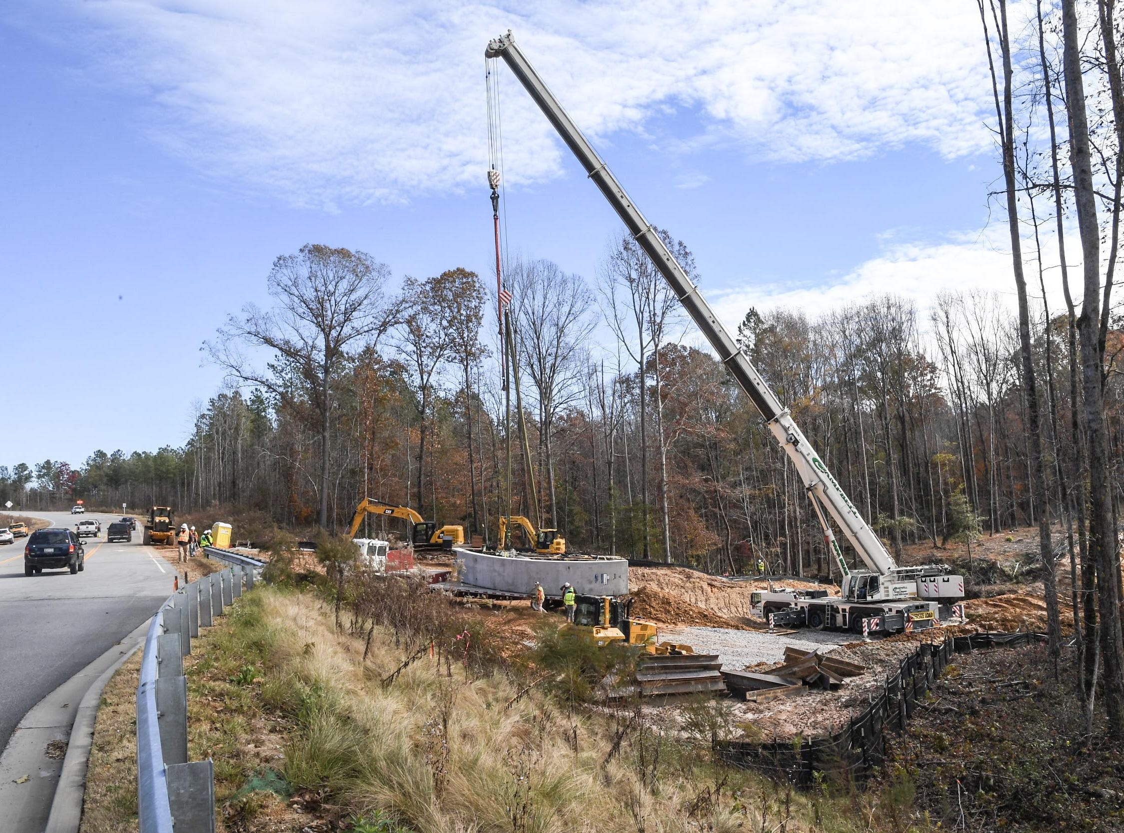 The TTi Innovation Center construction site is adding a bridge for a traffic route from the production center and the new facility near exit 27 on I-85. The Bebo style bridge, made with prefabricated pieces, is being installed with Campbell Crane Services by Morgan Corp. of Duncan, S.C. TTI's  $75 million innovation center that will bring 250 high-paying jobs to Anderson County. The research facility is a prelude to the addition of a 300,000-square-foot corporate headquarters/innovation center.