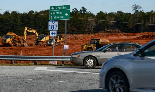 Motorists leaving I-85 enter S.C. 187 in Pendleton on Thursday. Grading machines work off of S.C. 187, a busy area on Clemson football game days. Expectations of growth with investors could come when sewer lines are installed, said Derrick Singleton, Anderson County director of wastewater treatment.