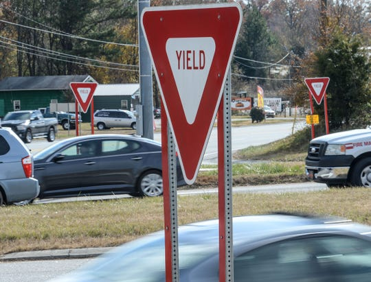 Motorists pass by many yield signs at one end on S.C. 187 at U.S.76 in Pendleton on Thursday. The road known as Wild Hog Road opened 54 years ago and has few large business features. The 10 miles of farmland between U.S.76 and I-85 at exit 14 has one high school, a convenience store, the Dollar General, the Clemson Research Park, and five churches along the way.