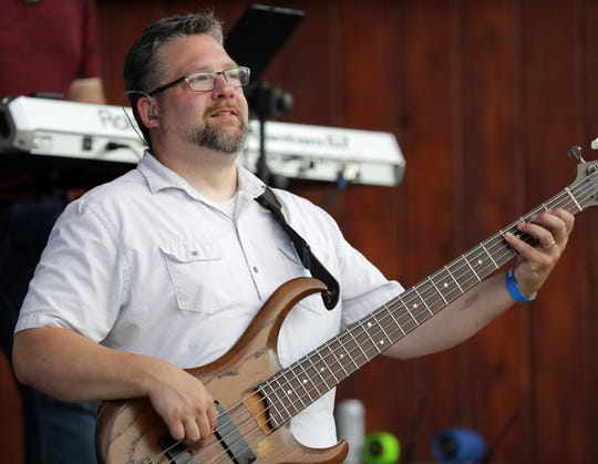 David Lange of Boogie & the Yo-Yoz plays at Memorial Park in Appleton in July.