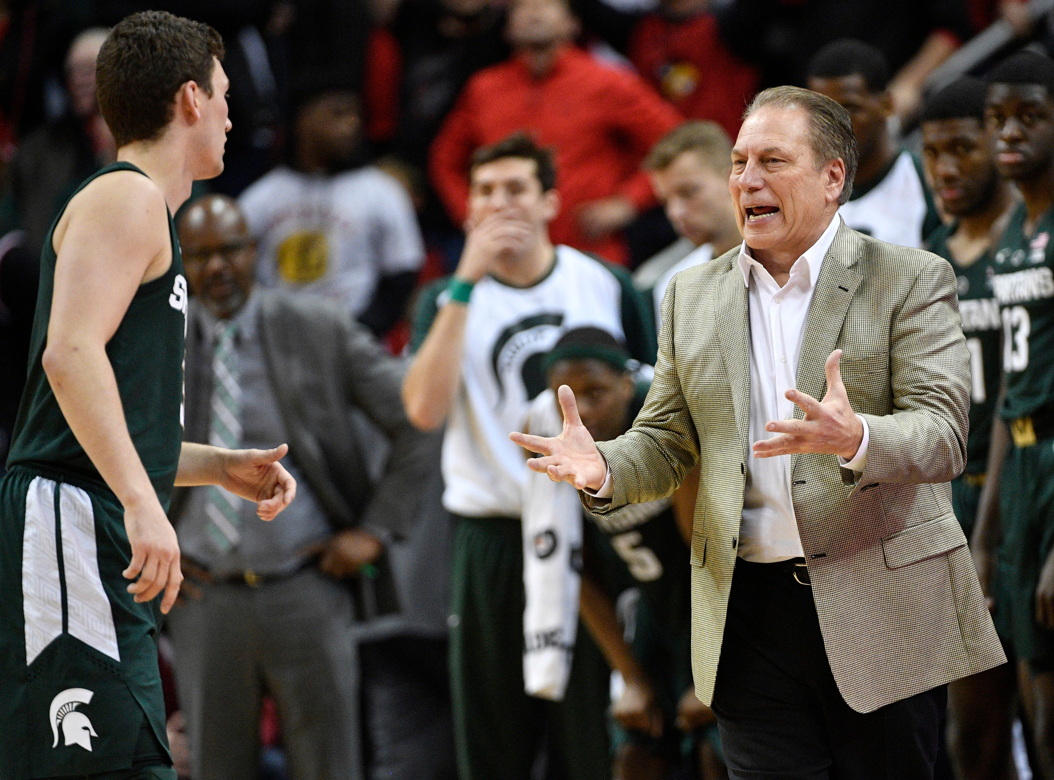 Nov 27, 2018; Louisville, KY, USA; Michigan State Spartans head coach Tom Izzo talks with guard Foster Loyer (3) during overtime against the Louisville Cardinals at KFC Yum! Center. Louisville defeated Michigan State 82-78.  Mandatory Credit: Jamie Rhodes-USA TODAY Sports
