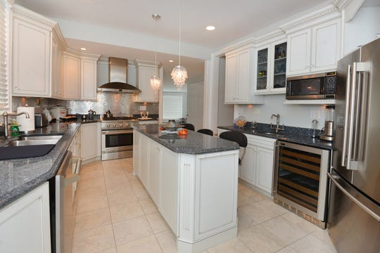 The kitchens feature a granite stone center island and recessed lighting.