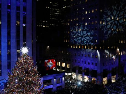 epa07196650 The Rockefeller Center Christmas Tree is illuminated during the annual tree lighting ceremony at the Rockefeller Center in New York, New York, USA, 28 November 2018. This is the 86th annual Rockefeller Center Christmas Tree Lighting Ceremony.  EPA-EFE/JASON SZENES