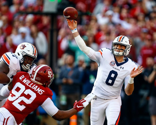 Auburn quarterback Jarrett Stidham (8) throws a pass during the first half against Alabama on Saturday, Nov. 24, 2018, in Tuscaloosa, Ala.