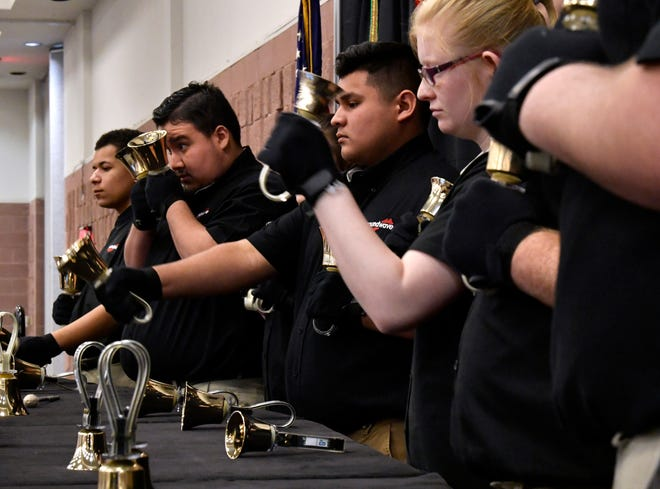 Members of Soundwave, the Abilene Independent School District handbell choir, perform during Thursday's annual luncheon for AISD retirees.