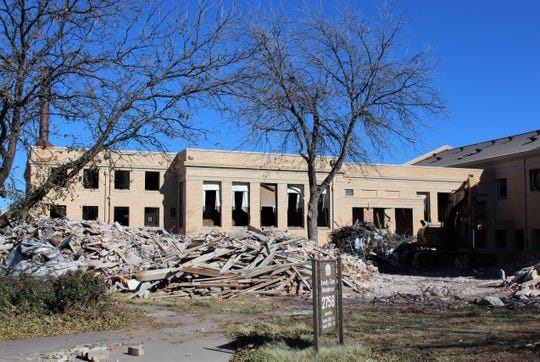 The stately look of the main building at Hendrick Home for Children presently is marred by materials removed from inside as part of a $18.7 million reconstruction project.
