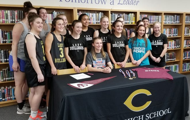 Clyde senior Kylah Holland, seated, is surrounded by members of the Lady Bulldogs cross country team at her signing ceremony Nov. 19, 2018. Holland signed to run cross country at West Texas A&M.