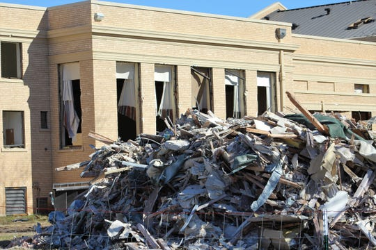 Rubble last week was piled outside the main building of Hendrick Home for Children. The remodel plan is to open a reconstructed building in June 2020.