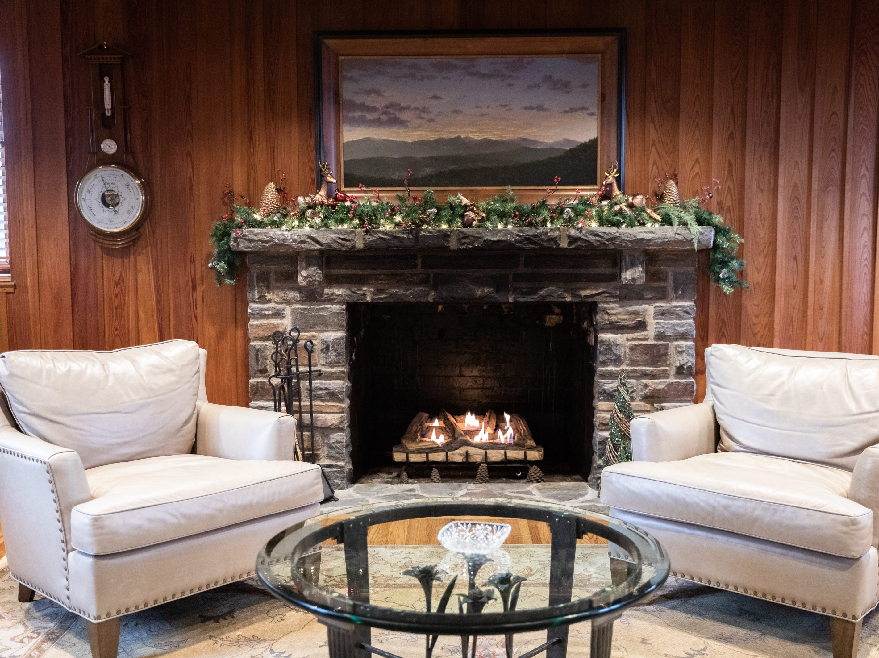 The fireplace in the den of the Governor's Western Residence on Patton Mountain Road in Asheville, decorated for the holidays.