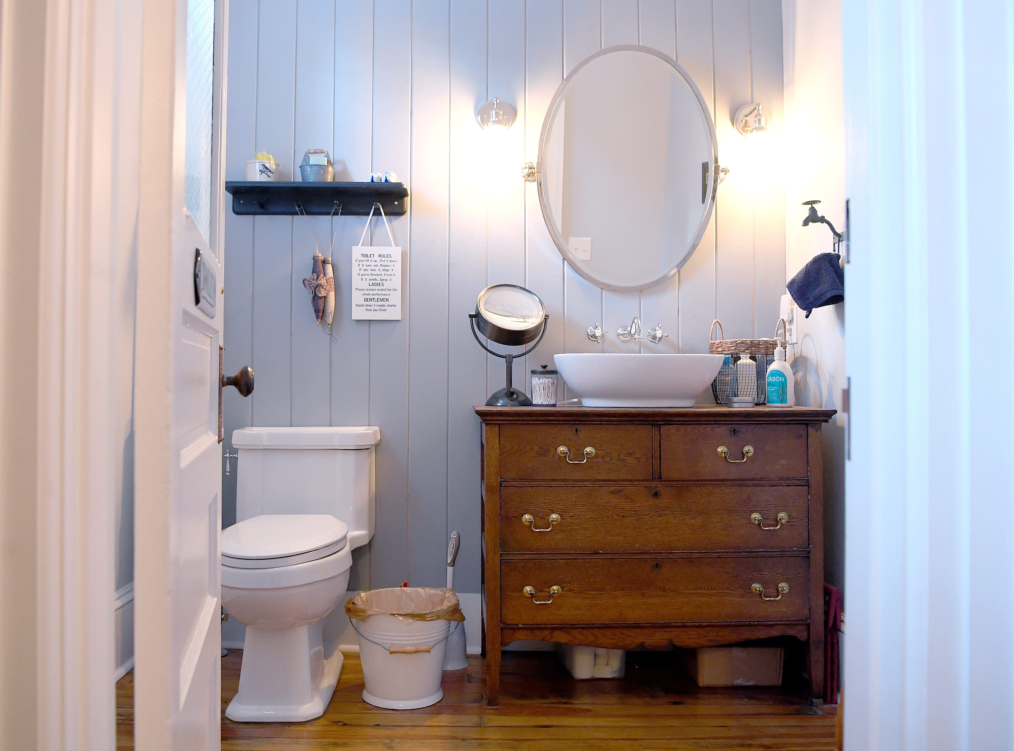 A dresser has been repurposed as a sink in the downstairs bathroom of Linda and Marc Voorhees' Montford home.