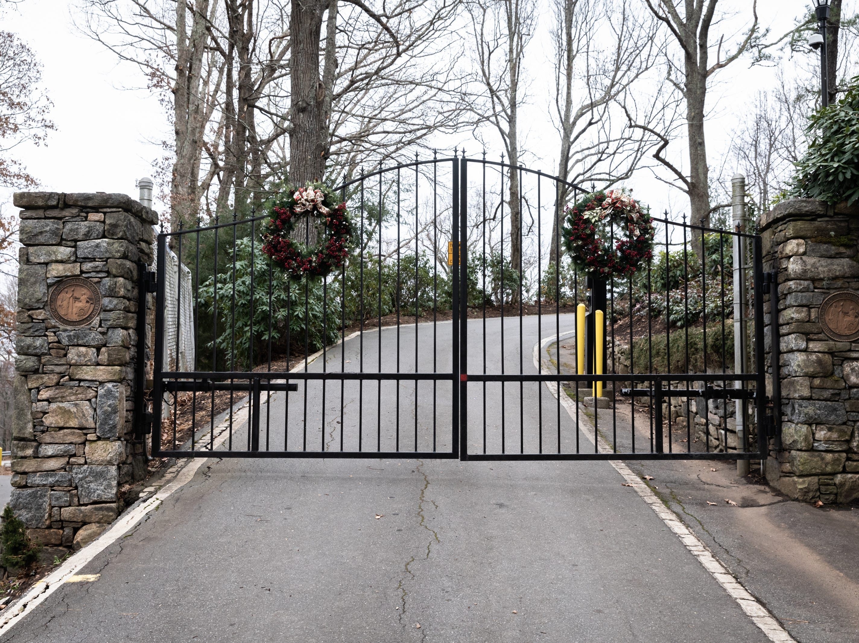 Holiday wreaths adorns the front gates of the Governor's Western Residence on Patton Mountain Road in Asheville.
