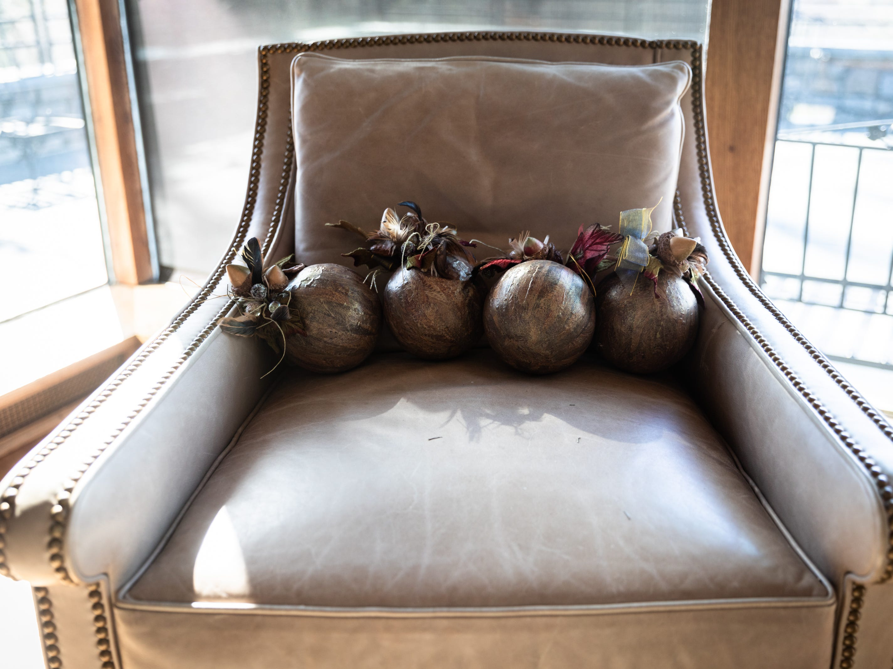 A chair in the living room of the Governor's Western Residence on Patton Mountain Road in Asheville, decorated for the holidays.