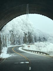 Icicles dangle from the Craggy Pinnacle Tunnel on Tuesday, Nov. 27. Ice- and snow-covered roads at the parkway's higher elevations has led to widespread closures to vehicles.