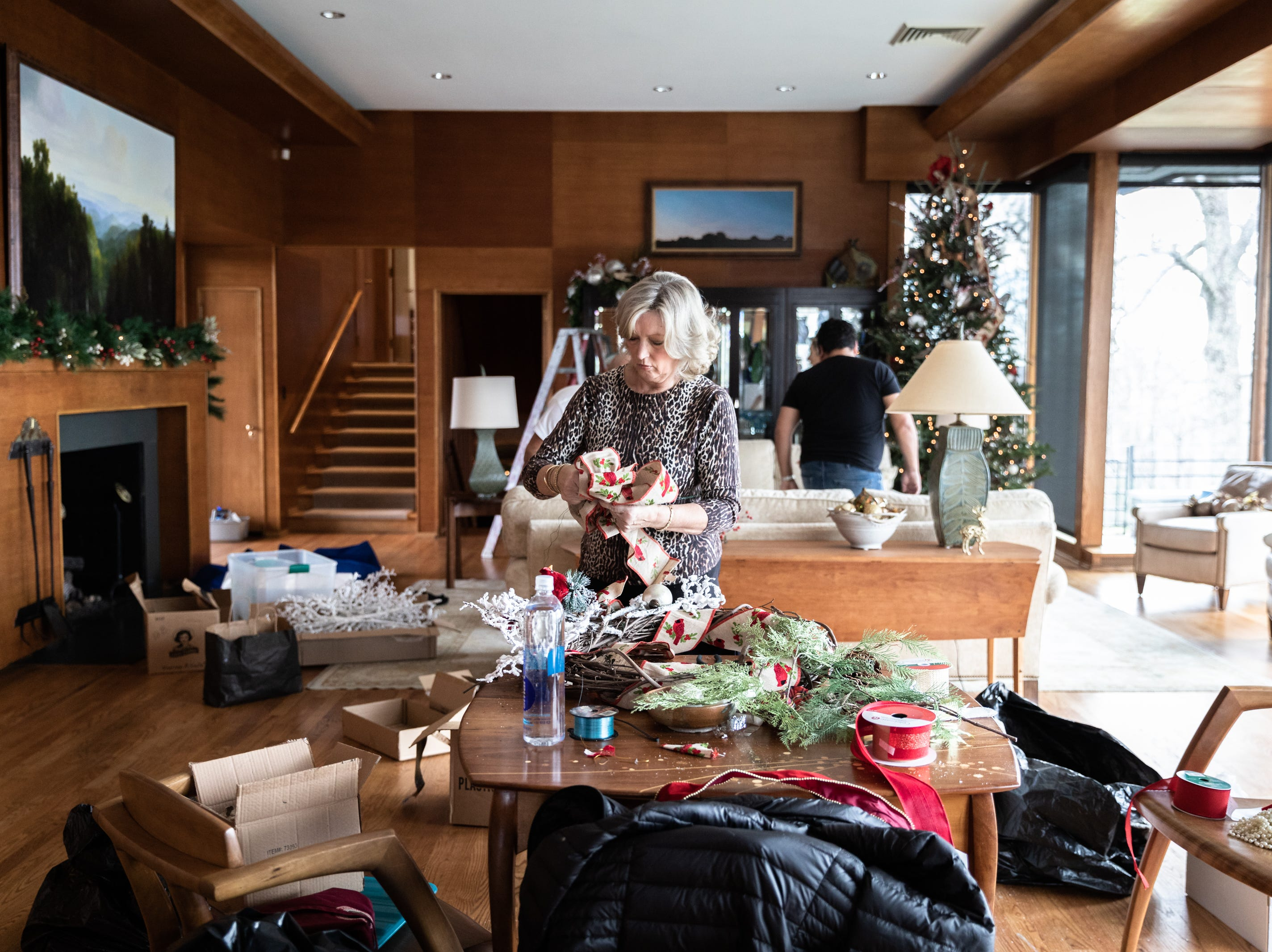 June Ray, of Waynesville, a member of the Governor's Western Residence Board of Directors, works on assembling a wreath for the holidays at the residence on Patton Mountain Road in Asheville, Nov. 29, 2018.