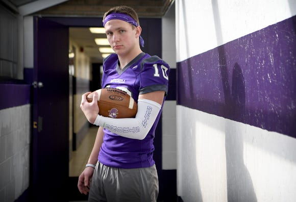 """Mitchell junior wide receiver Tyler McKinney wears a special armband for his brother which reads """"Seth Strong"""" after he died at age 15 due to an unknown birth defect in October. Since the tragedy McKinney says that he has changed his style of play. """"Now I'm trying to have fun and play the way I know he would want me to and that's to use every ounce of my abilities to the best of my ability,"""" he said."""