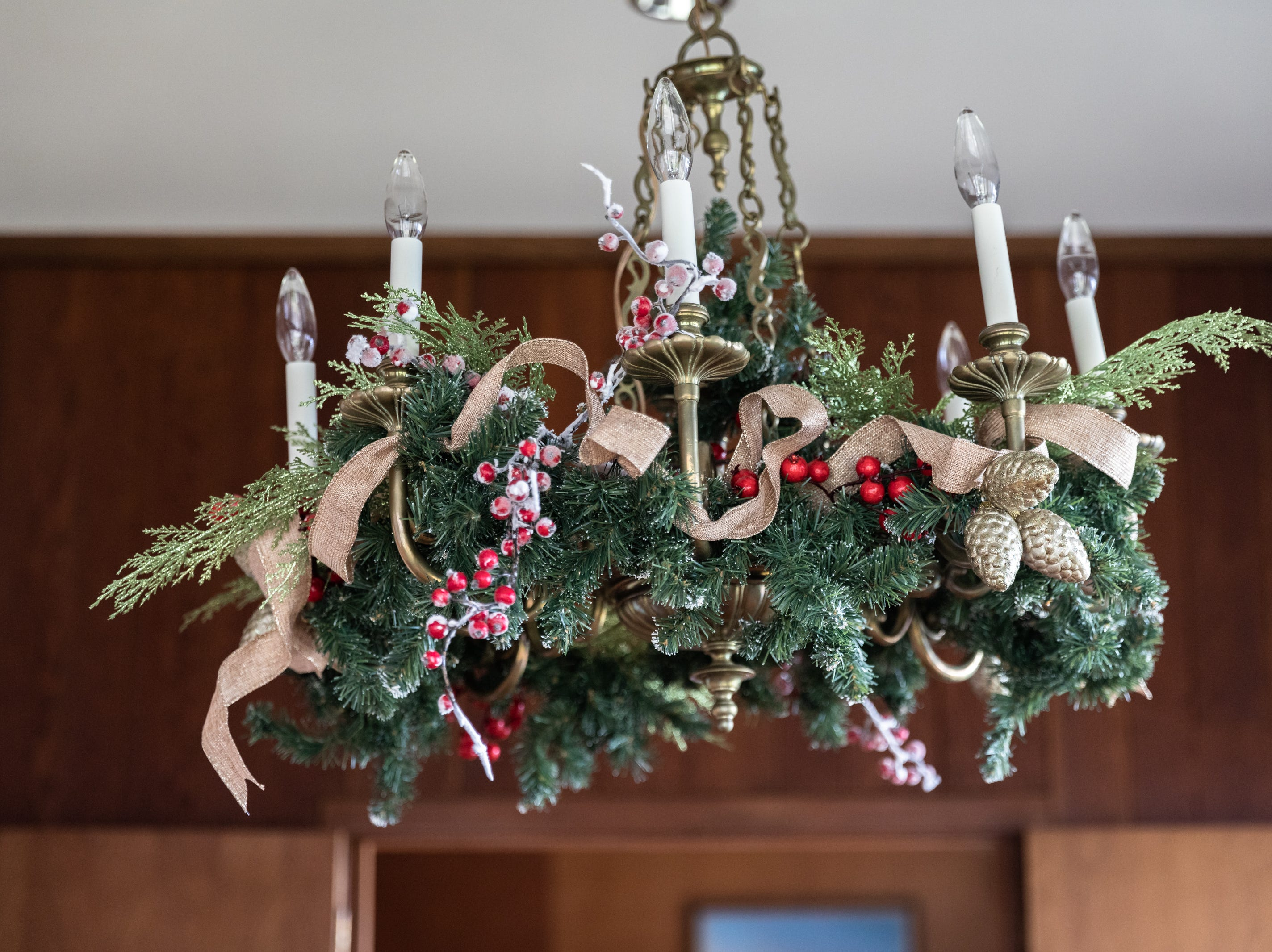 The chandelier in the dining room of the Governor's Western Residence on Patton Mountain Road in Asheville, decorated for the holidays.
