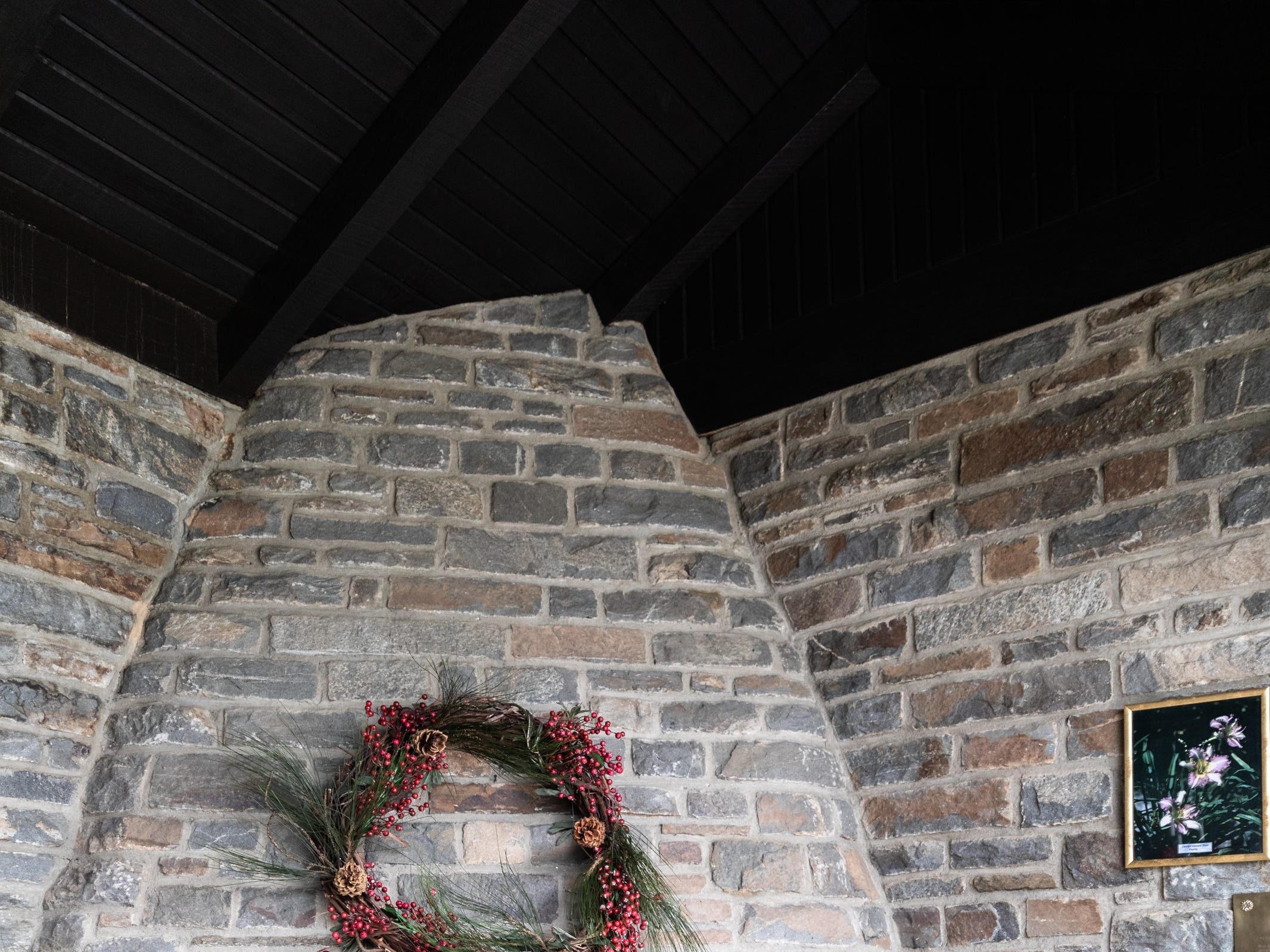 The fireplace in the foyer of the Governor's Western Residence on Patton Mountain Road in Asheville, decorated with a wreath for the holidays.